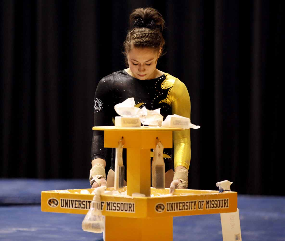 Mizzou freshman Madeleine Huber takes a moment by herself at the chalk station before heading over to the floor routine area Friday evening, Feb. 19, 2016 at the Hearnes Center.
