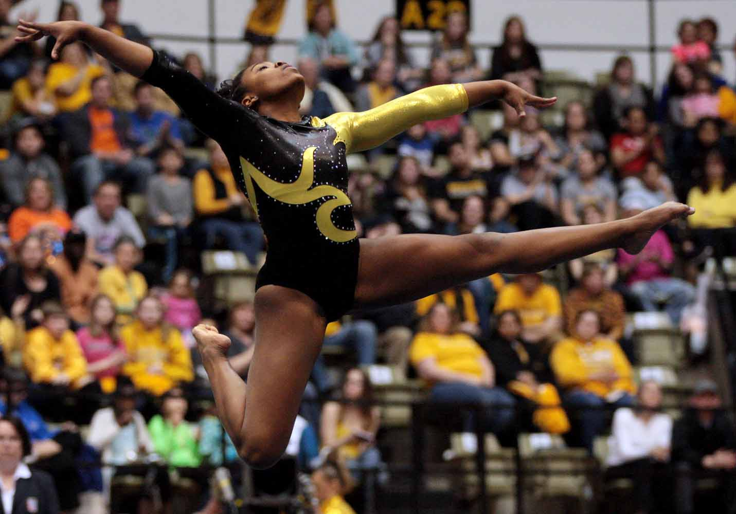 Mizzou sophomore Kennedi Harris leaps into a pose during her floor routine Friday evening, Feb. 19, 2016 at the Hearnes Center near the end of the gymnastics competition against the University of Florida.