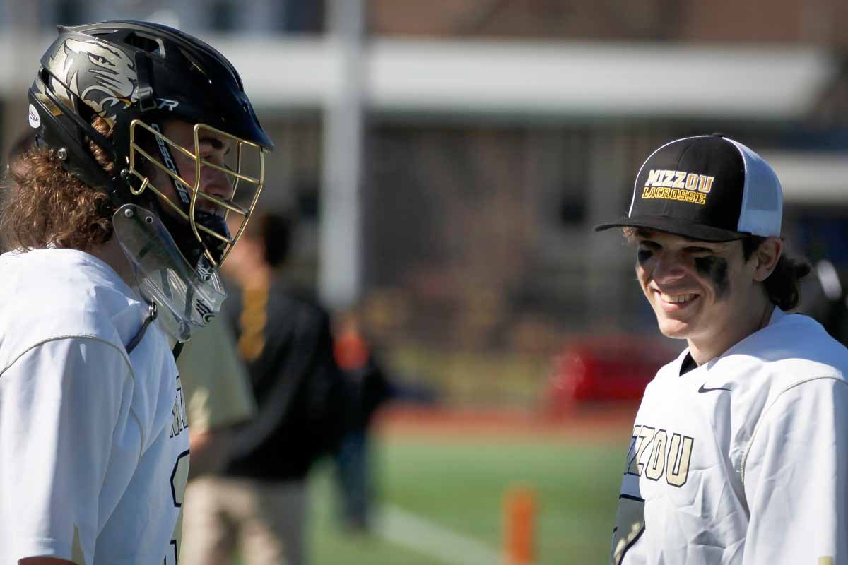 From right, Mizzou's sophomore Matt Needham laughs with freshman John Marshall on the sideline during a timeout of the game against Oklahoma State University Sunday, Feb. 21, 2016 on Stankowski Field.
