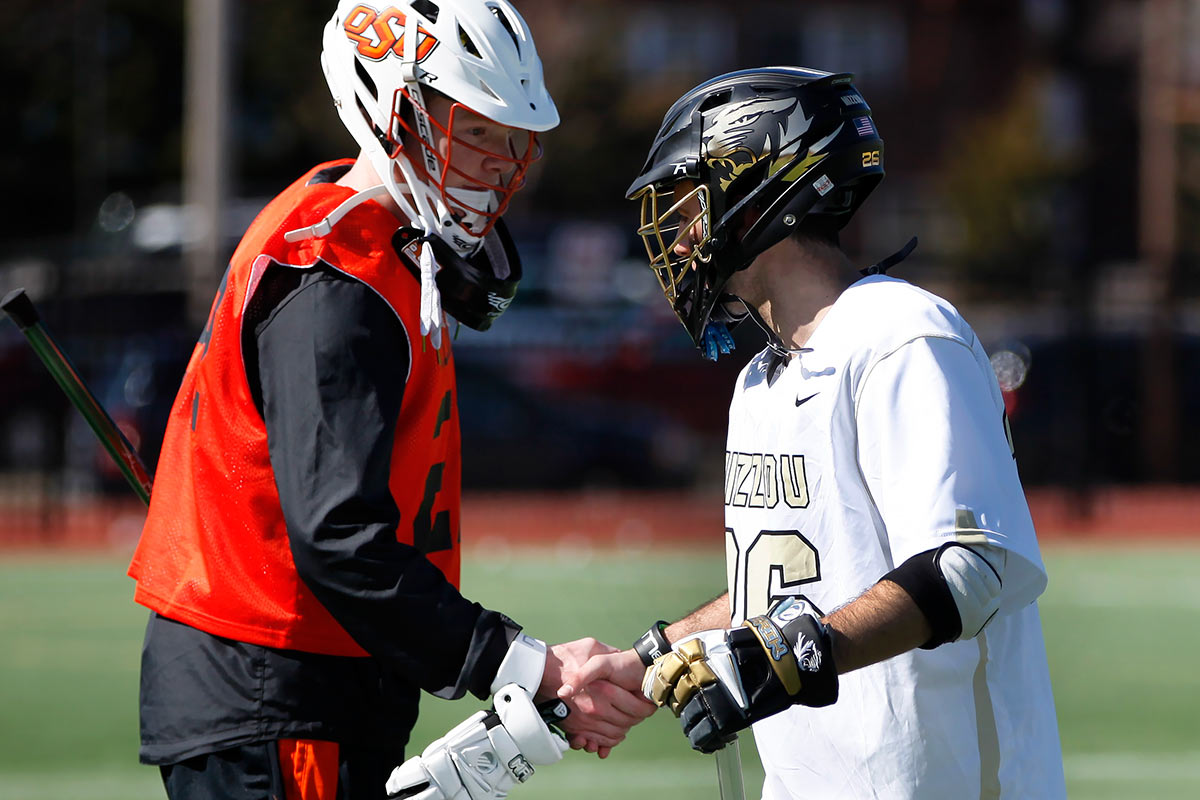 Mizzou Lacrosse Team Captain Phil Bergman (26) shakes hands with an Oklahoma State University player at the conclusion of the game on Stankowski Field Sunday, Feb. 21, 2016. Mizzou won 13-0.