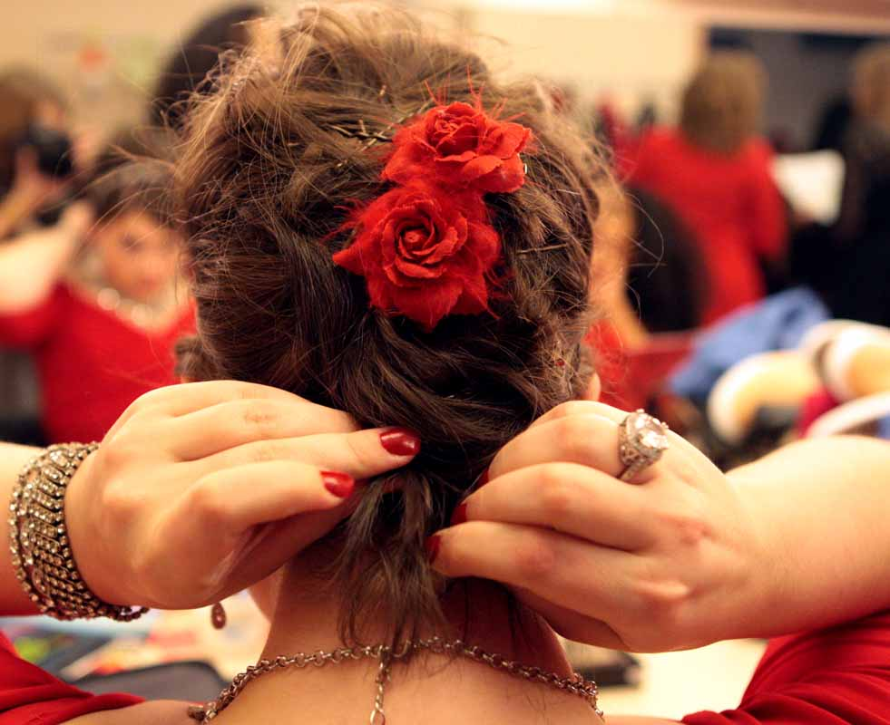 "Sophomore student Sydney O'Dear pins her hair back in the dressing room of Jesse Auditorium Saturday evening, Feb. 27, 2016 before performing in the Vagina Monologues. O'Dear performed in the ""My Angry Vagina"" skit that opened the second act of the show."