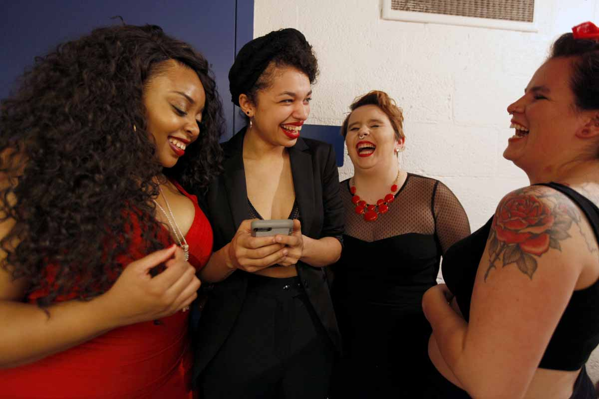 "From left, KeAnn ""KeKe"" Mays-Lenoir, Deja Mackey, Mayme Jordan and Laura Farrington laugh at a photo on Mackey's phone prior to their performance in the Vagina Monologues, Saturday, Feb. 27, 2016. The four all performed together in a skit that closed out the first act of the show."