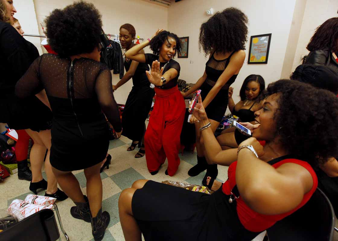 Alanna Diggs, middle, dances with other actresses performing in the Vagina Monologues in one of the dressing rooms of Jesse Auditorium before the Vagina Monologues Saturday evening, Feb. 27, 2016.