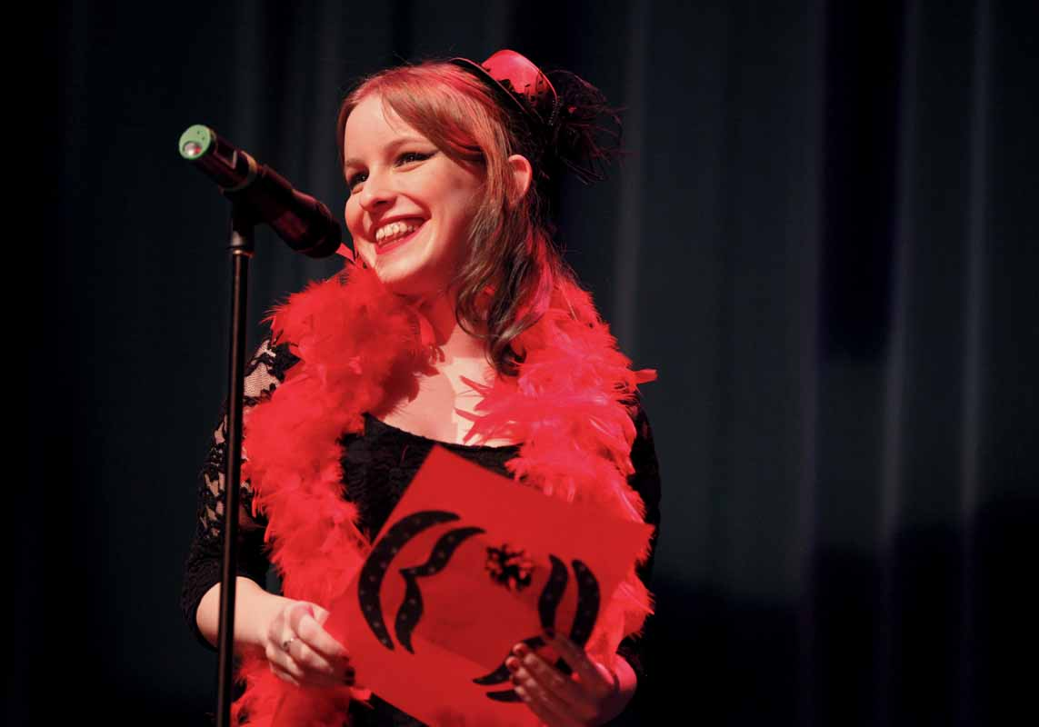 "Wendy Hayworth smiles during her performance of ""Vagina Happy Fact"" during the Vagina Monologues Saturday evening, Feb. 27, 2016 in Jesse Auditorium."