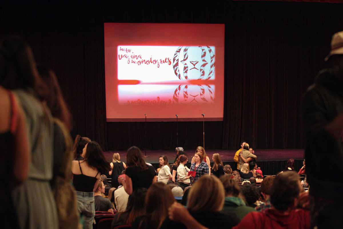 """MU Vagina Monologues"" reads out on the on-stage projector in Jesse Auditorium during intermission of the performance Saturday evening, Feb. 27, 2016."