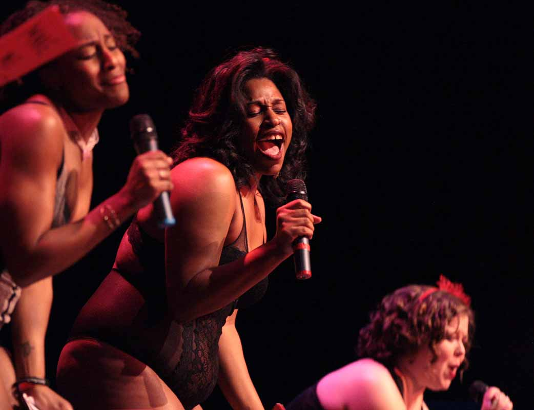 "India Gibbs, middle, moans during her performance in ""The Woman Who Loved To Make Vaginas Happy"" in the Vagina Monologues Saturday evening, Feb. 27, 2016 in Jesse Auditorium."
