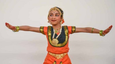 Girl in traditional Indian dance costume.