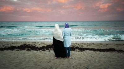 Two wmen staring at the sea.