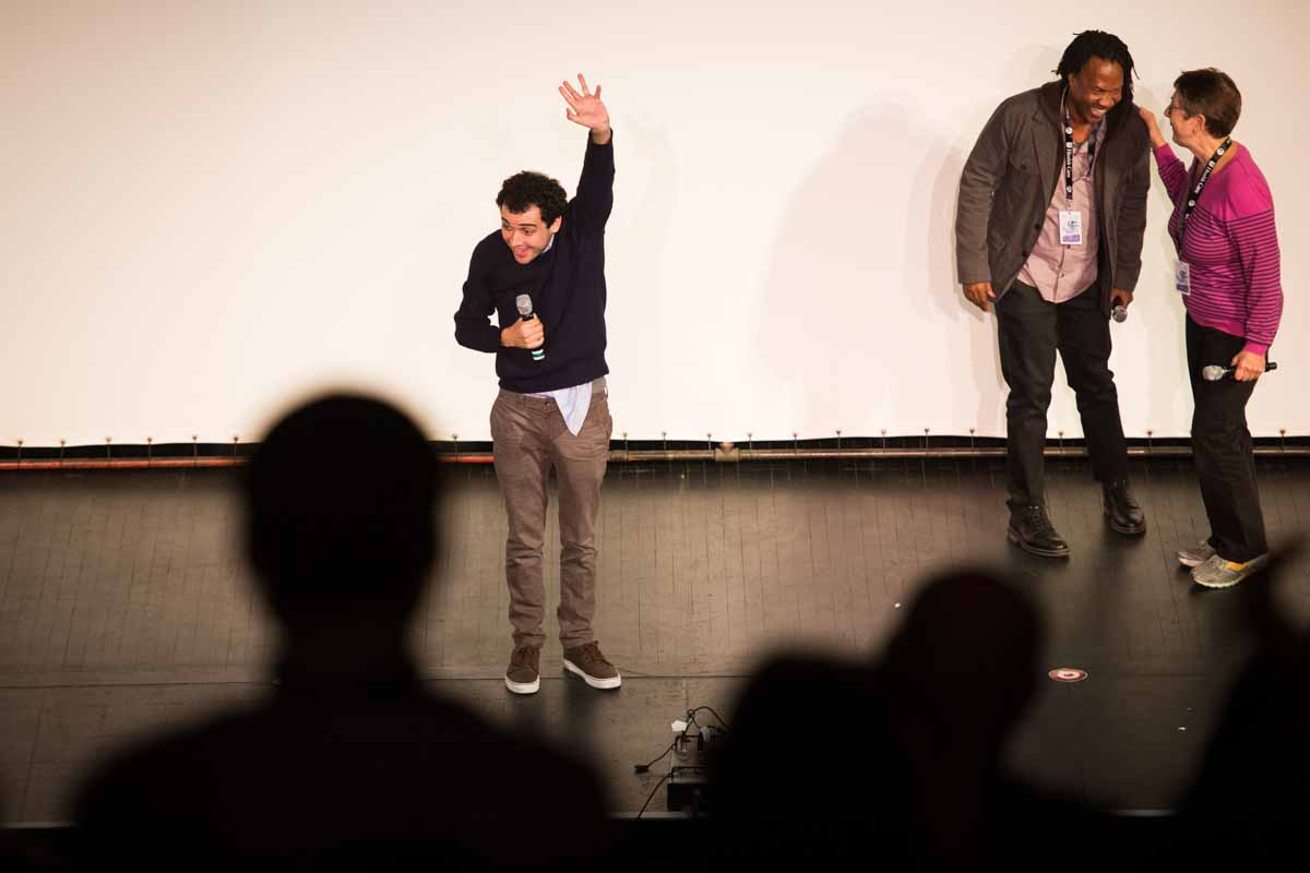 Special guest Owen Suskind, the main subject of 'Life, Animated,' waves to a standing crowd at the Missouri Theatre on Thursday night. Photo by Shane Epping.