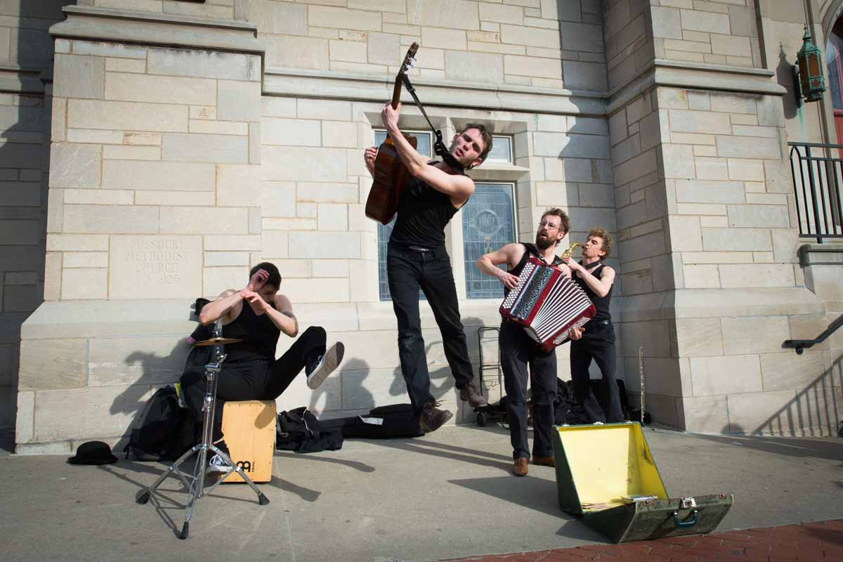 Back by popular demand, French tricksters Les Trois Coups perform on 9th Street in front of the United Methodist Church. With a quick witted, quick moving charm and musicality they bound around spaces- into ears and hearts- with the wild abandon of a gypsy night. Photo by Shane Epping.