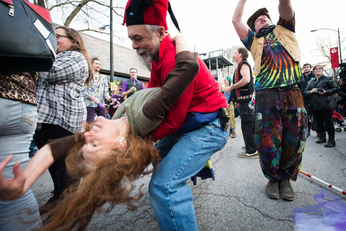Parade attendees dance on 9th Street before movies begin on Friday night. Photo by Shane Epping.