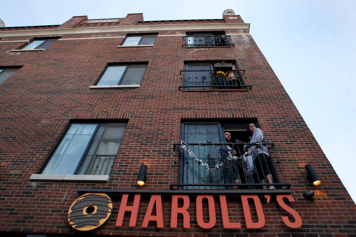 Spectators view the annual March March parade from their apartments above Harold's Donuts. Photo by Tanzi Propst.