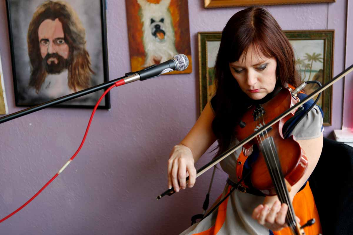 """Molly Healey plays the violin during her song """"Flight"""" at Sparky's Homemade Ice Cream Friday afternoon, March 4, 2016 during the True/False Film Festival's Sparky's Friday Showcase. Photo by Tanzi Propst."""