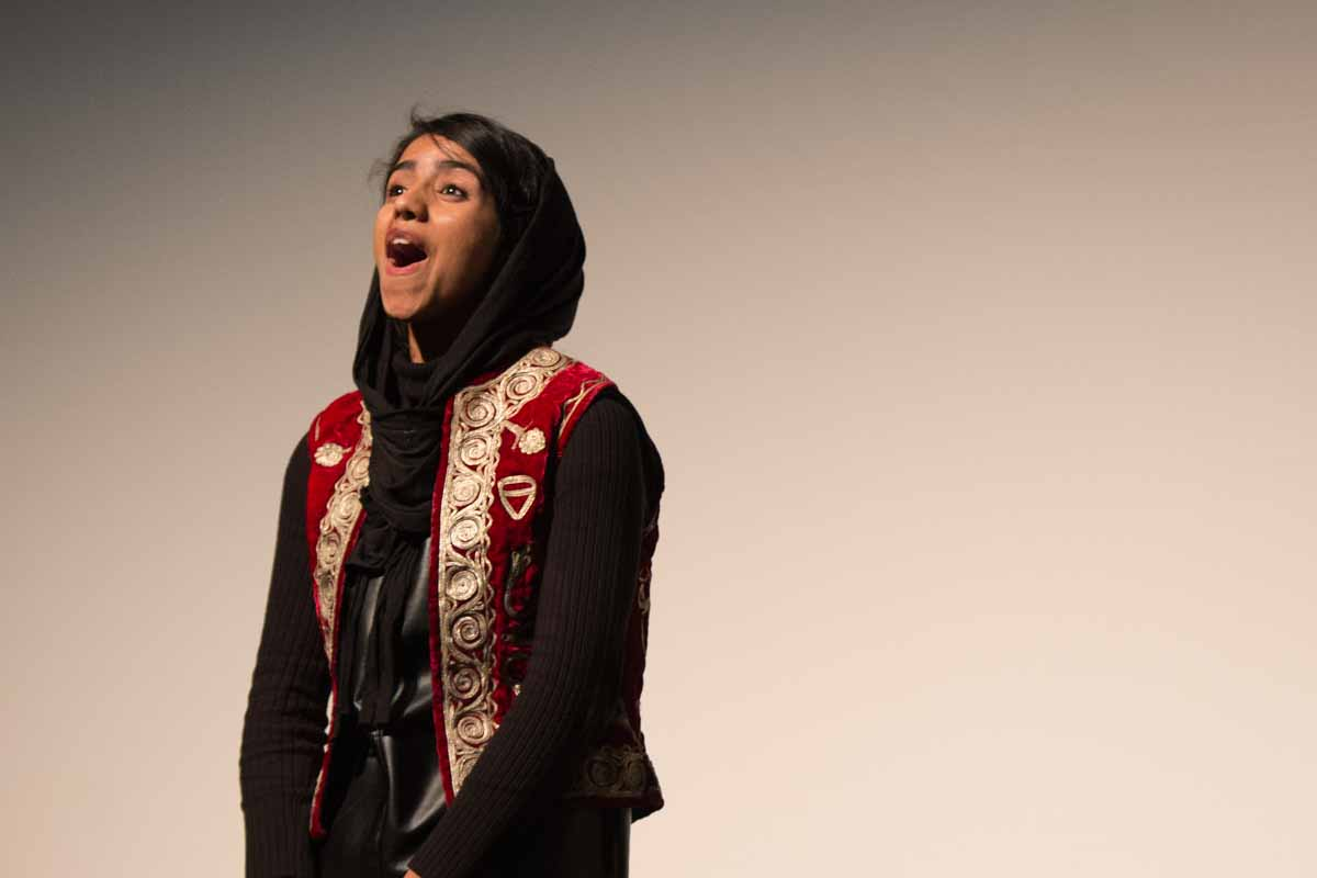 Sonita Alizadeh performs on stage at Jesse Hall and receives a standing ovation. Photo by Shane Epping.