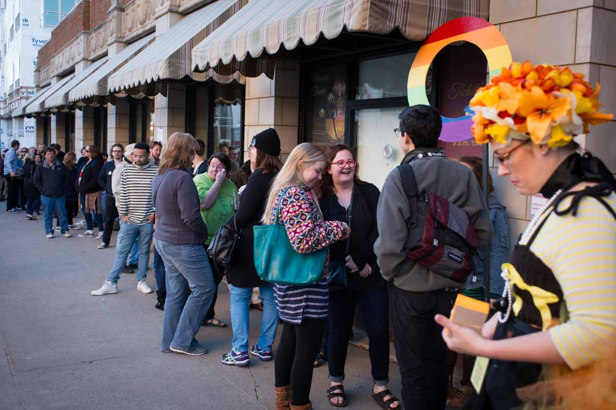 Movie goers wait in line at the Q in front of the Missouri Theater in hopes of attending the next film if room allows. Photo by Shane Epping.