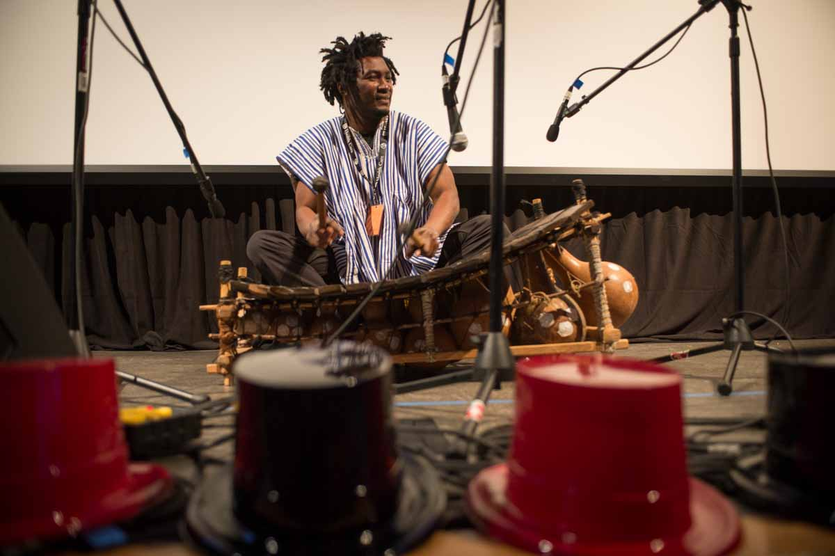 SK Kakraba performs at the Picturehouse. The Ghanaian gyil is an instrument made from dried gourds, the wood of rare fallen trees and the silk of spiders. A relative of the xylophone, it resonates with an eerie, soulful buzz that hums through generations. Photo by Shane Epping.