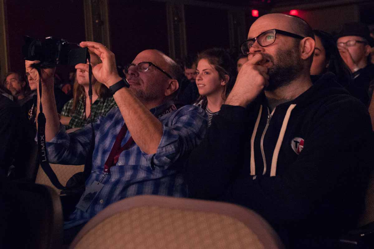 Stacey Woelfel and Robert Greene sit in the second row at the Missouri Theatre as directors Adam Dietrich, Kellan Marvin, and Varun Bajaj address the auditorium about their film #ConcernedStudent1950 Saturday evening. Photo by Tanzi Propst.