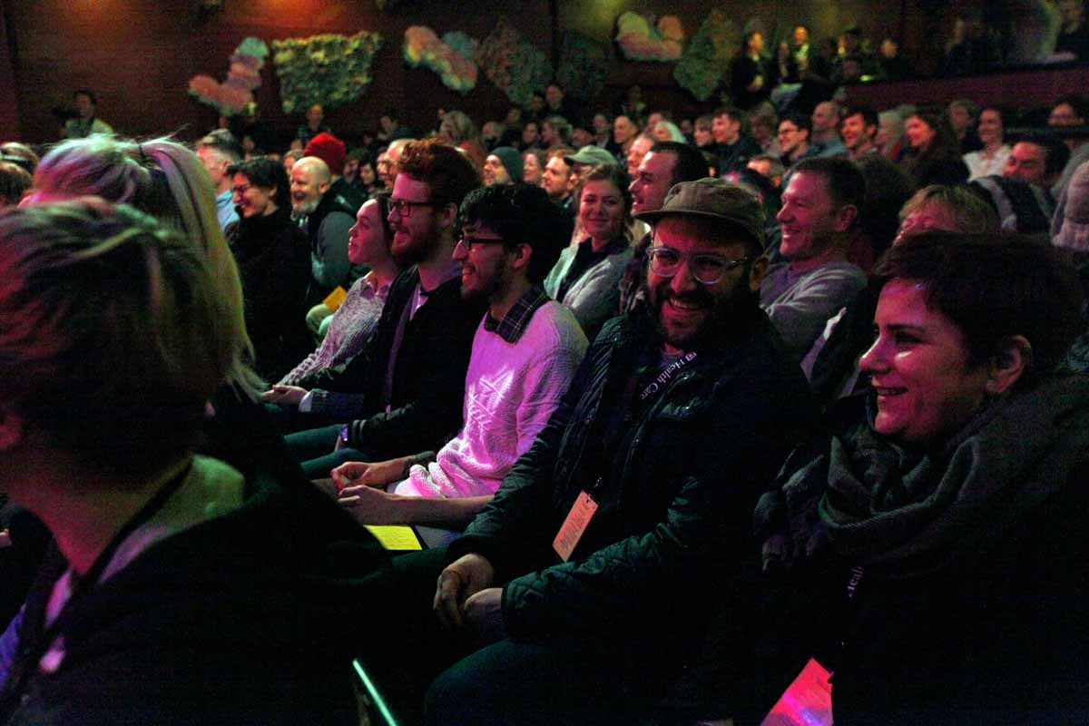 Gimme Truth! attendees laugh during host Johnny St. John's comedic dialogue at The Blue Note Saturday evening. Photo by Tanzi Propst.