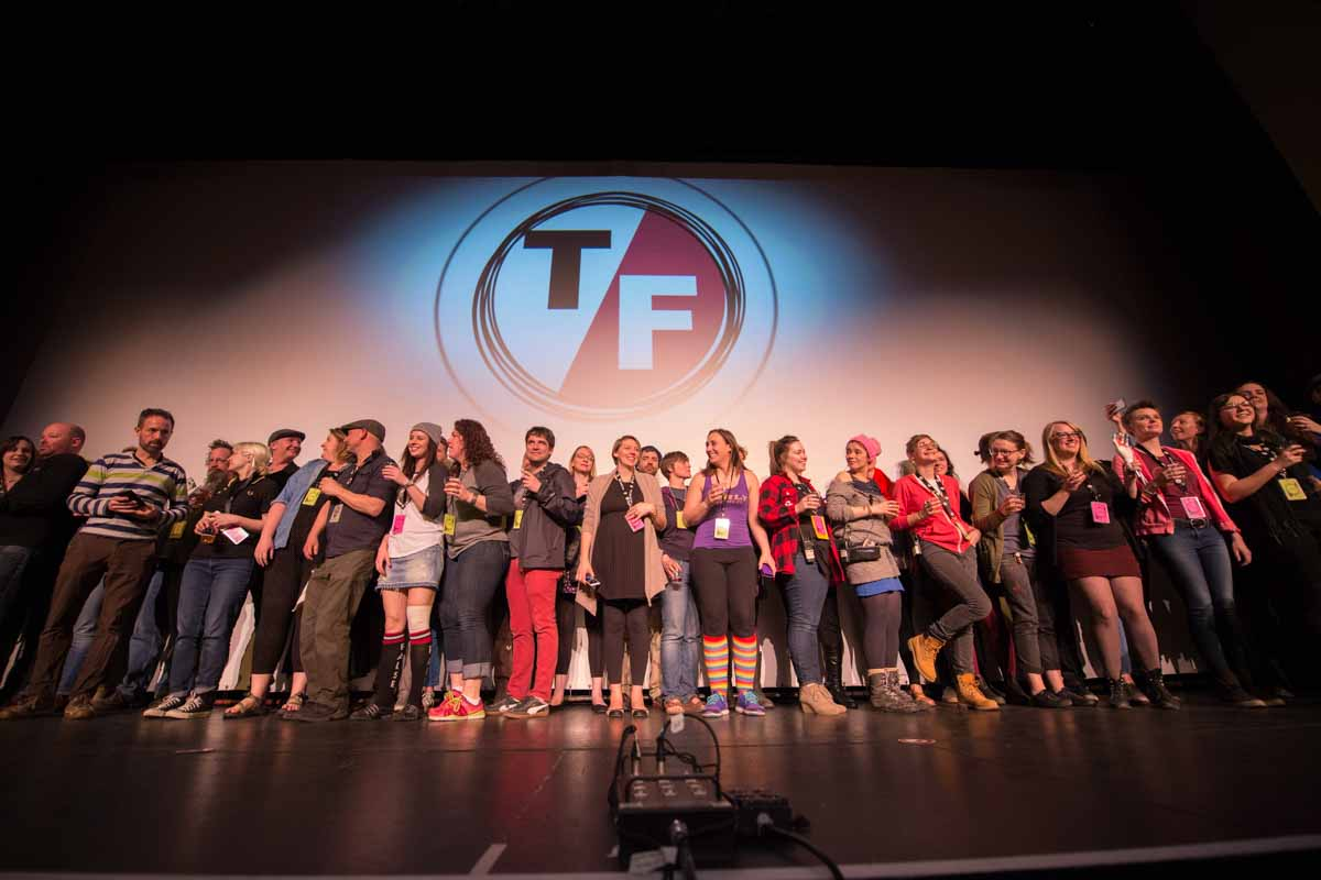 The core volunteers of the True False Film Festival take the Missouri Theatre stage for a standing ovation near the end of the festival. Photo by Shane Epping,
