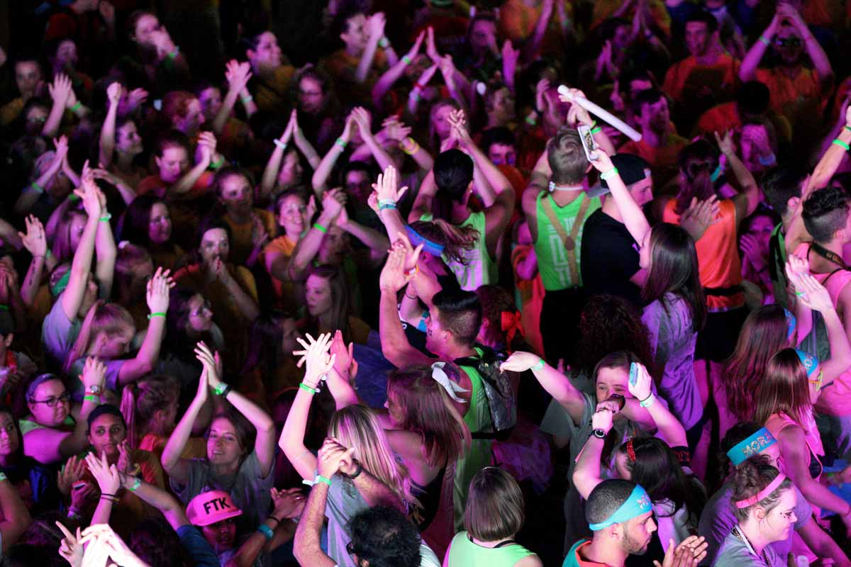 Dancers jump around together during Power Hour at MizzouThon. Leadership members and morale captains threw around glow sticks for dancers to make glasses, bracelets and necklaces out of.