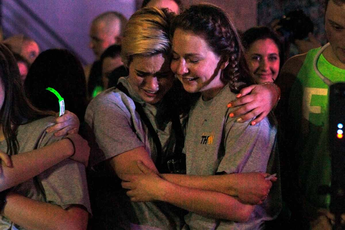 "Senior Ellen Hinze cries, hugging senior Erin Ehlers as Miracle Families make the rounds to cut off the wristbands of each dancer at the end of MizzouThon. ""Ellen, you're crying because it's over and I'm smiling because it happened,"" Ehlers said."