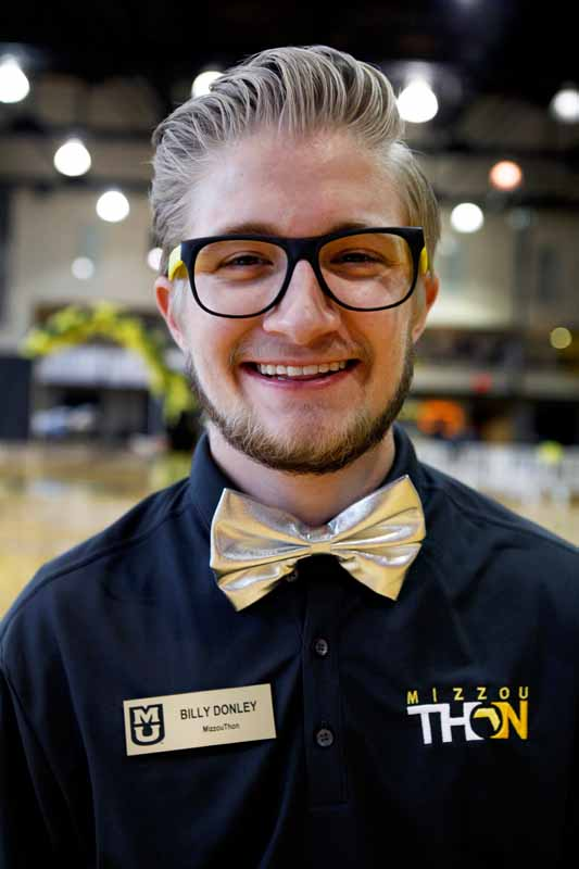 Sophomore Billy Donley shows off his shiny silver bowtie and Mizzou-themed sunglasses (minus the glass) before MizzouThon's main event Saturday morning. Donley is also RHA president.