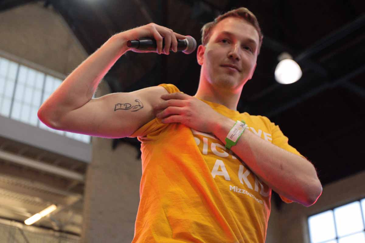 "Zack Newman shows his tattoo during his speech about ""Zacking"" during the main event Saturday, March 12, 2016. After his friend Zachary Lederer passed away from brain cancer, Newman decided to get a tattoo in his honor. ""LTD"" to honor Lederer's motto ""Living the Dream"" and the flexed arm to mimic the pose he would make while going through treatment. ""It means hope. It means positivity. It's a reminder that we're not moving in isolation and can make an impact onto one another,"" Newman said. ""I've outlived him, but I won't let his spirit die."" Newman encourages everyone to follow @ZachingVsCancer on Twitter."