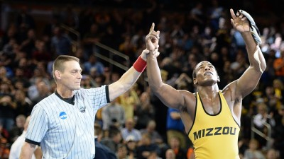J'den Cox and referee.