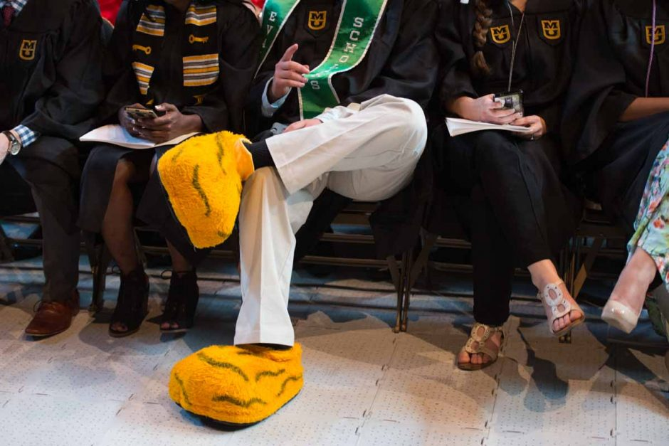 A friend of Truman's sits in the front row during commencement ceremonies. Photo by Shane Epping.
