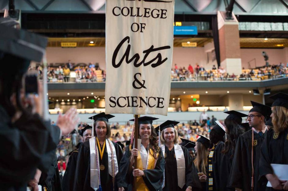 Students attend commencement ceremonies for the College of Arts & Sciences at Mizzou Arena on Saturday night. Photo by Shane Epping.