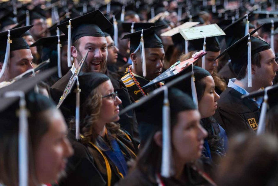 Many graduates wore a smile before walking on the stage and receiving their degrees. Photo by Shane Epping.