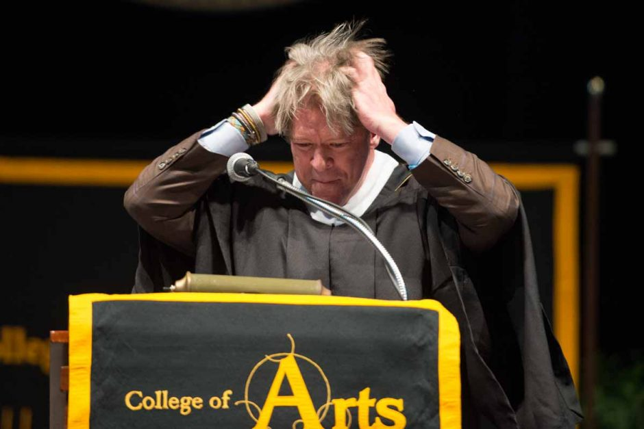 Commencement speaker Major Garrett, BA '84 political science, BJ '84, messes up his hair as part of his speech to graduates. Photo by Shane Epping.
