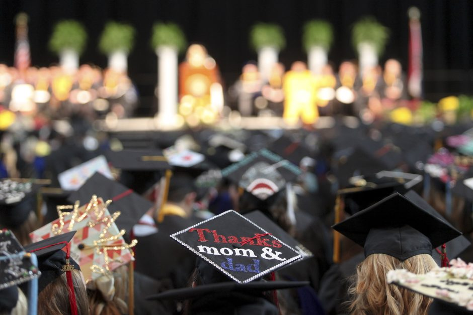 A message to parents decorates the top of a mortar board during Honors Convocation Saturday at Mizzou Arena. Photo by Rob Hill