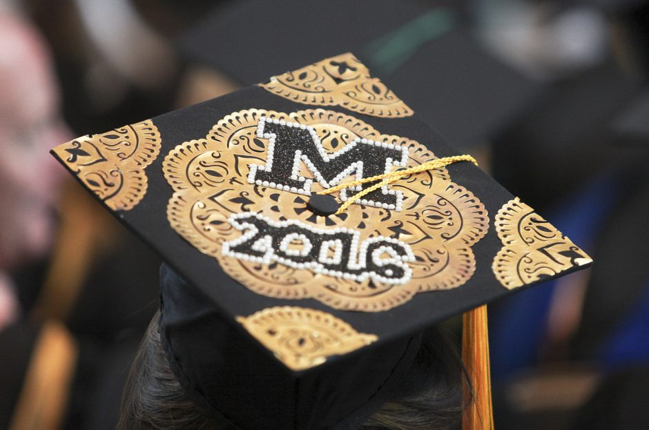 University of Missouri graduation ceremonies are marked with a cap and gown message during Honors Convocation Saturday. Photo by Rob Hill