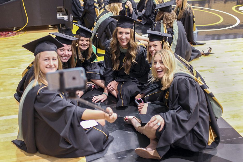 School of Health Professions graduates entertain themselves by taking a selfie before the start of the school's graduation ceremony Sunday . From left, they are Catherine Bean, Melissa Zemke, Alysia Carey, Carrie Schuebel, Kelsey Kramper and Rachel Lazenby. Photo by Rob Hill