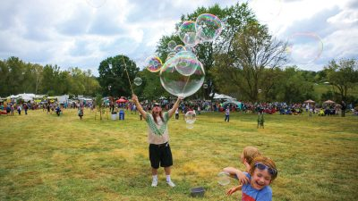 Man making giant bubbles at the Roots N Blues N BBQ festival