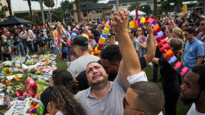 People grieving at a vigil in Orlando.