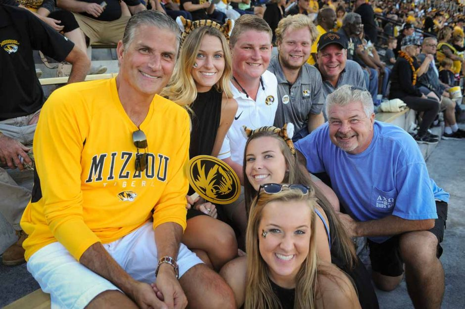 Members of the Pawelski and Giroux families enjoy watching the game from their seats on the east side of Memorial Stadium.