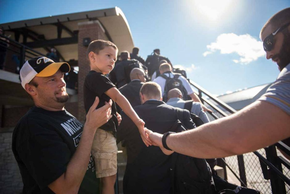 Carter Bexten, 2, and his father, Jeremy, show their support for the Mizzou Football team as they arrived to the stadium.