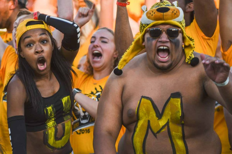Members of Tiger's Lair show off their colors immediately preceding the kick off.