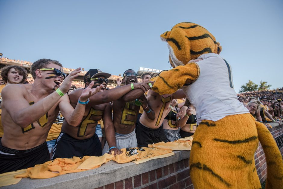 Truman The Tiger embraces some of his biggest fans in the Tiger Lair student section on Saturday.