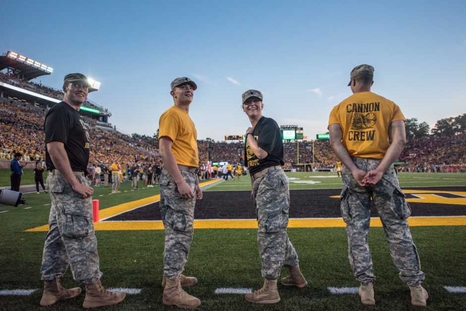 Mike Mizerny, Rob Dettmer, Becca Moss, and Jacob Thompson share a laugh as they look towards the jumbotron during a timeout at the Mizzou football game.