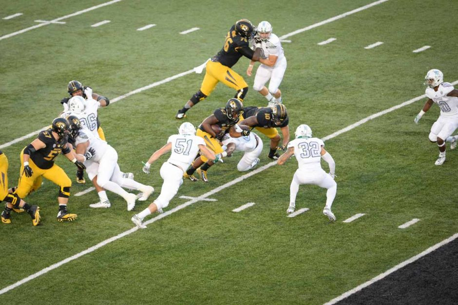 Junior running back Ish Witter rushes for four yards to the Eastern Michigan three yard line.