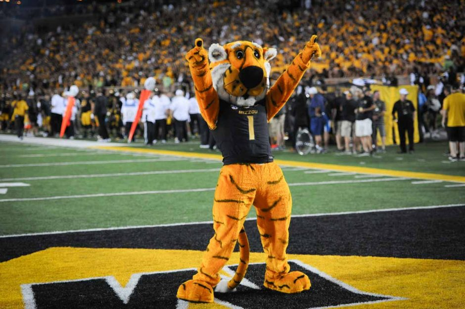 Truman points to fans in the south end zone after doing 14 pushups in honor of MU's 14 offensive points.