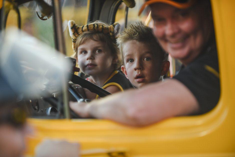 Kids in yellow truck.