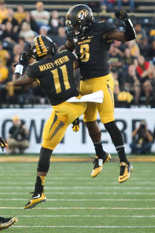 Defensive back Aarion Maxey-Penton and safety Thomas Wilson celebrate after gaining possession back for Missouri.