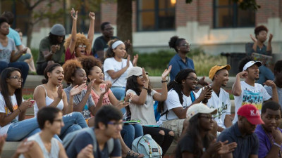 Students watching a performance on Traditions Plaza