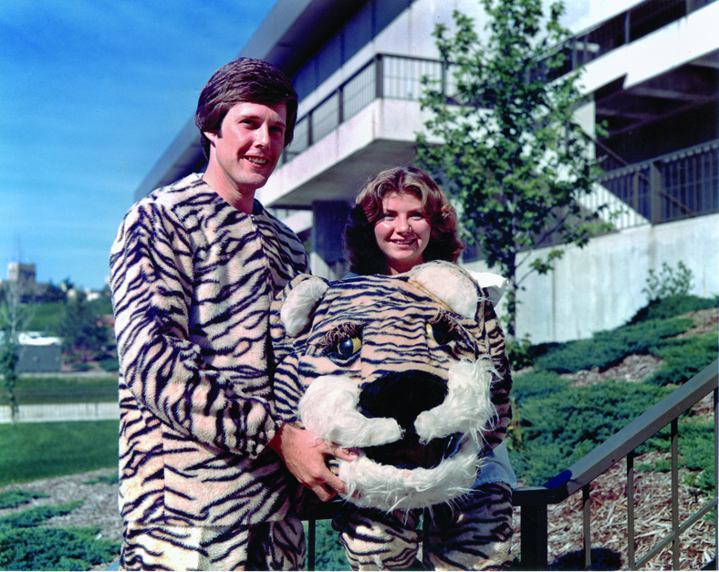 Debbie Snellen, BS Ed '79, MA '80, and Steve Wendling, BS Ag '78, posed with their Big Tiger and Lil Tiger garb in front of the Hearnes Center. Photo courtesy of the Savitar.