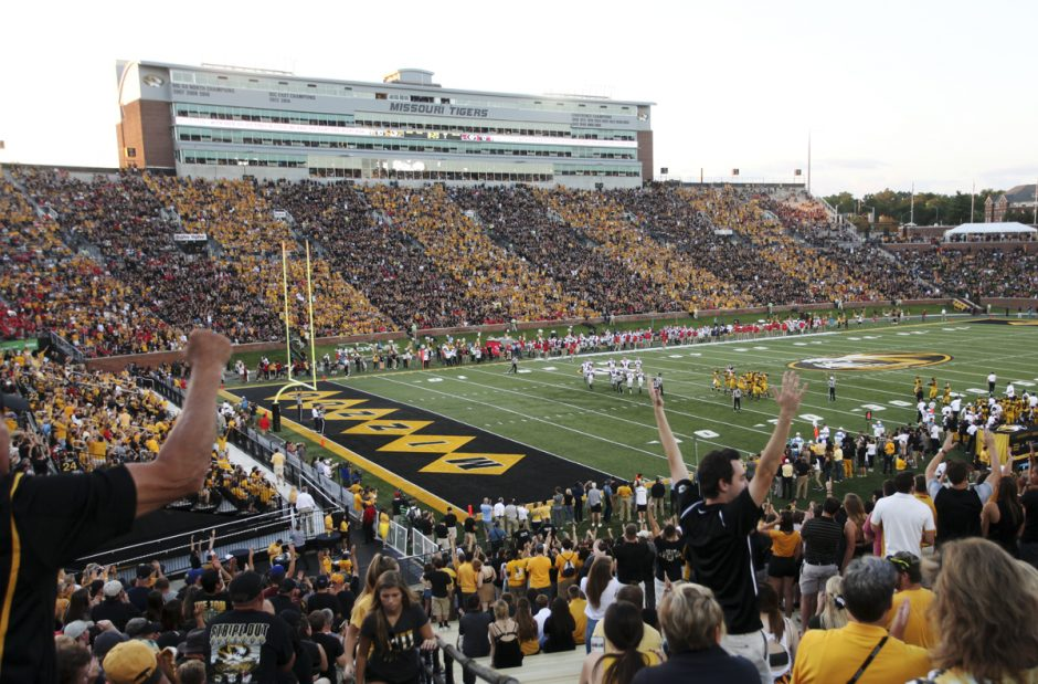 Memorial Stadium with fans in black and gold.