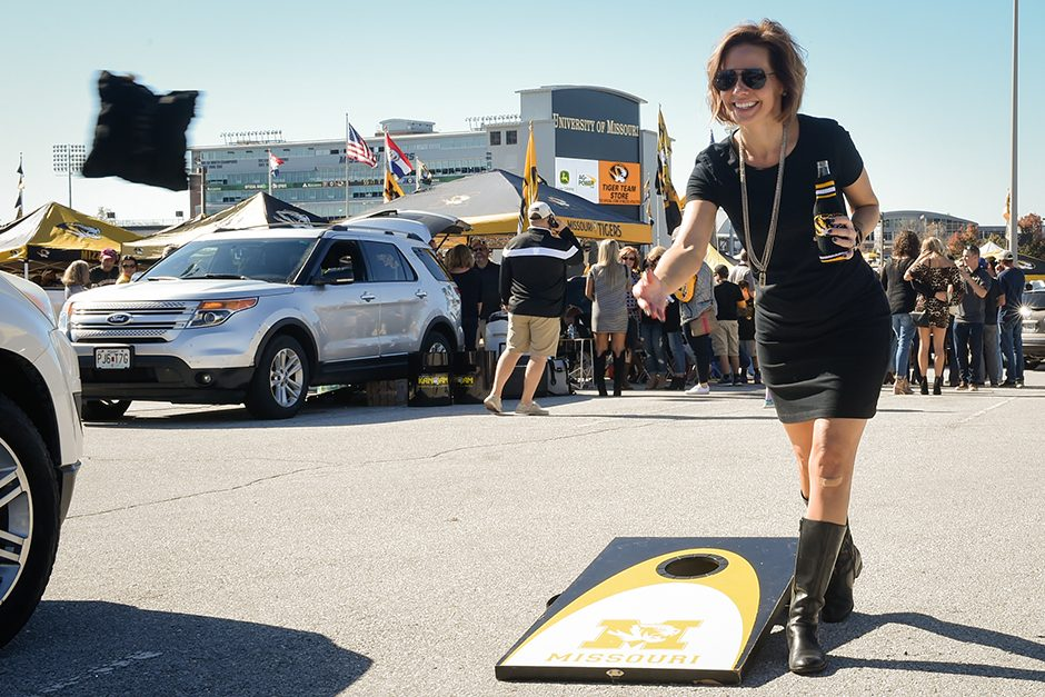 Tamara Ferguson throws a bag of corn while playing a game of cornhole with fellow pre-game tailgaters. Photo by Shane Epping.